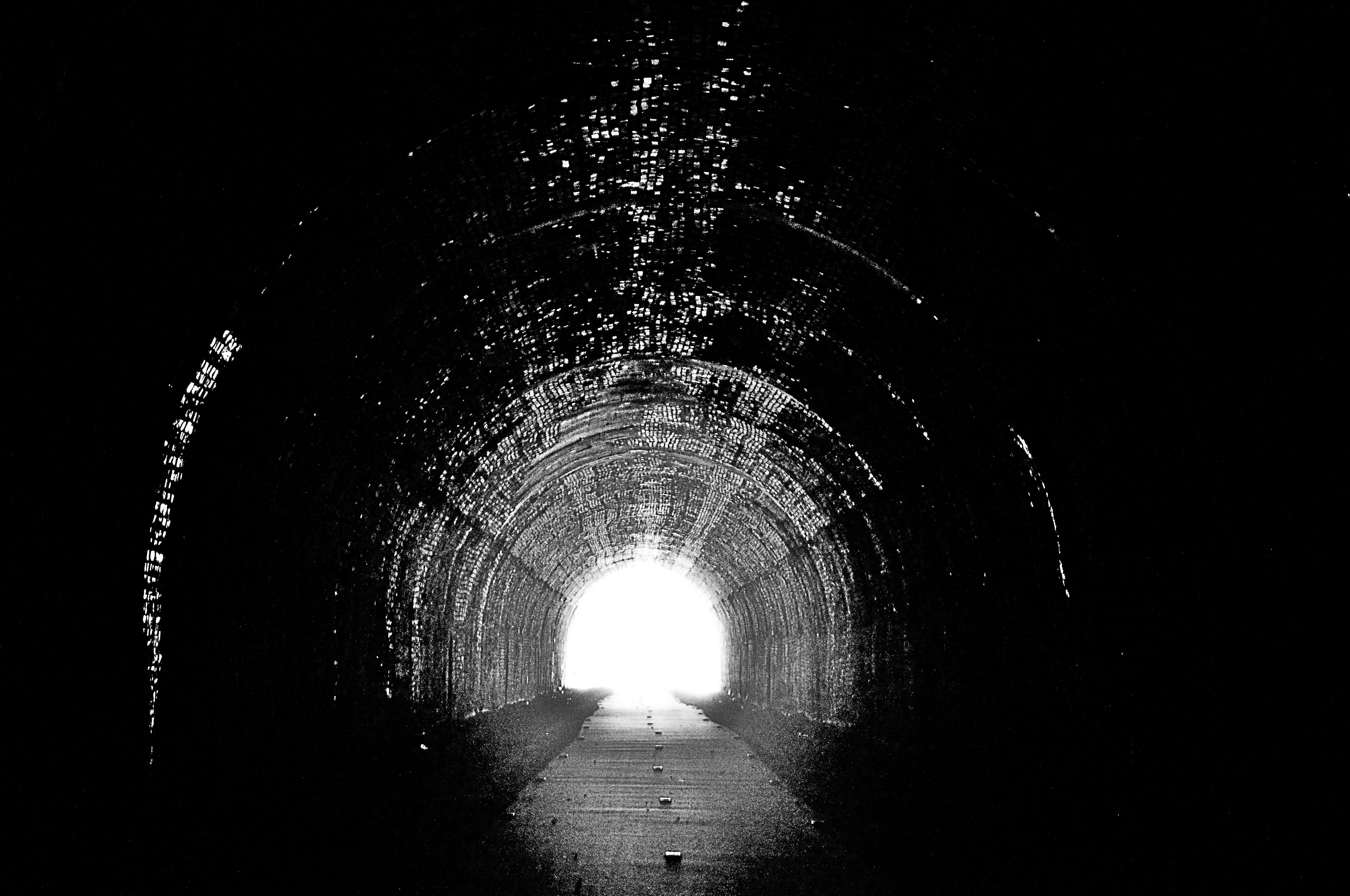 there is a light at the end of the tunnel There's always a light at the end of the tunnel so the saying goes faith is believing that it's not a train barreling straight at you somewhere in the first year after my brain injury, the result of a suicide attempt, i quit running scared to death, panicky and out-of-breath through the tunnel in the other direction – away from the light.